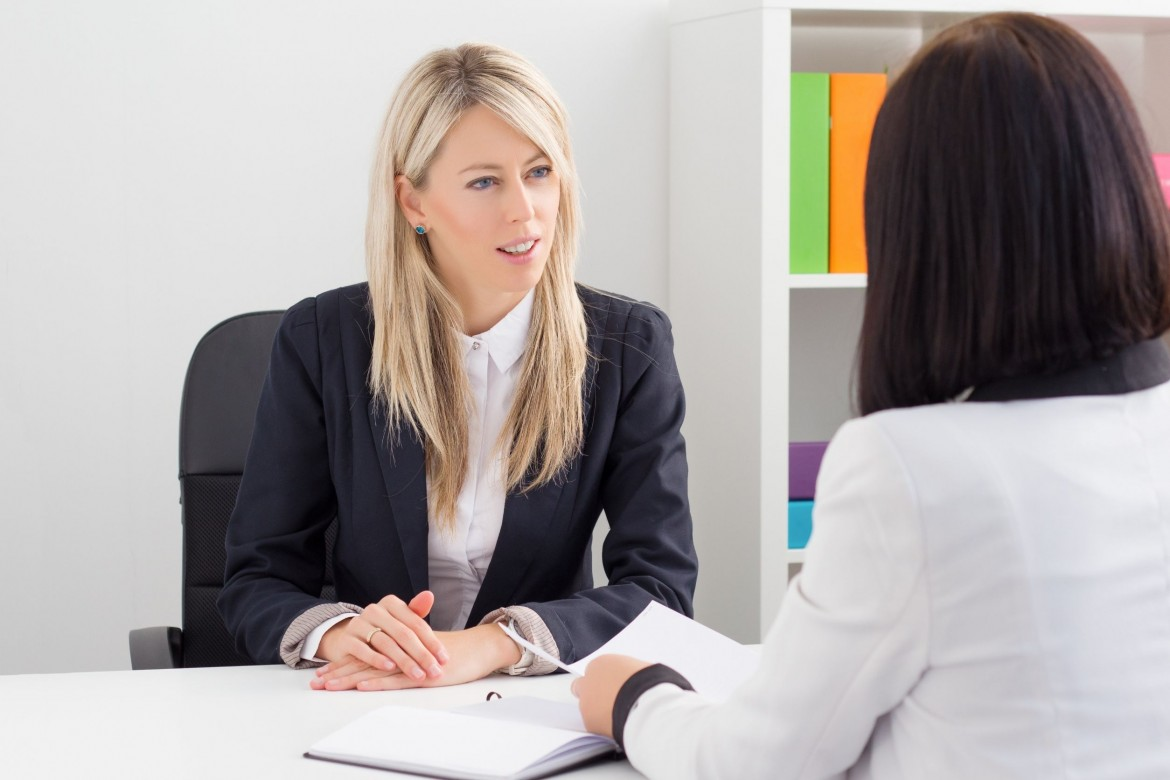Human resources agent asking questions to hire employees for her company