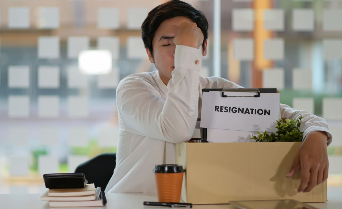 Employee turnover about to happen since sad employee has packed his things in a box and wrote his resignation letter to quit his job