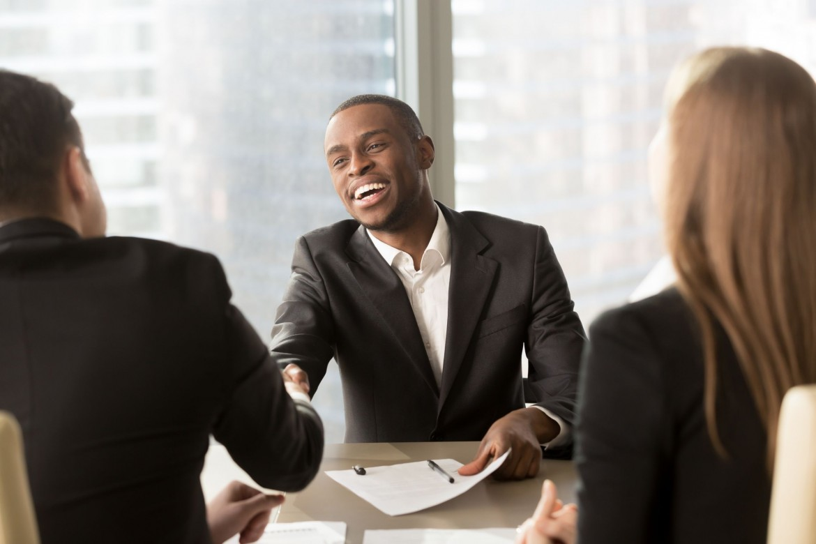 black man shaking hands to man after accepting job offered during the hiring process