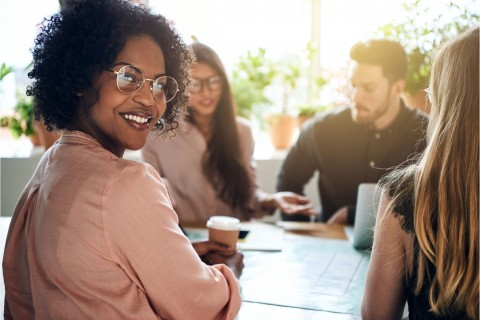 smiling woman happy about the diversity in the workplace that her company has