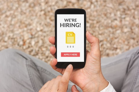 marketing for recruiters concept image where candidate gets job opportunity ad on iphone